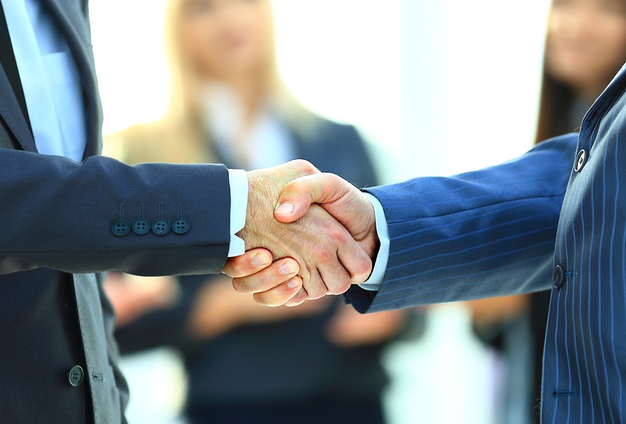 Business handshake. Business man giving a handshake to close the