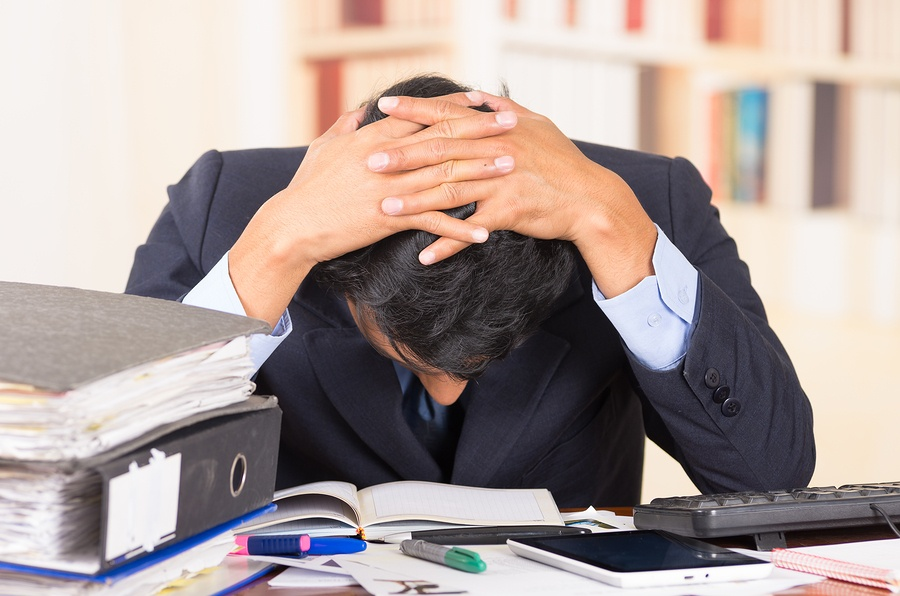 bigstock-young-stressed-overwhelmed-man-83153765